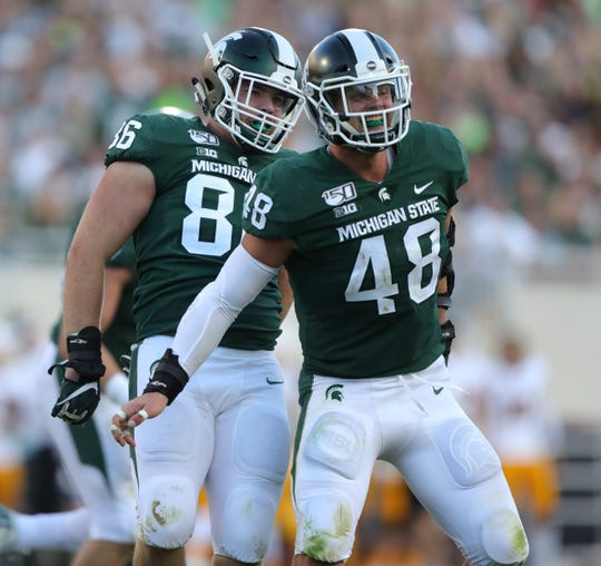 Michigan State Spartans' Drew Beesley (86) and Kenny Willekes (48) after a stop against Arizona State during the second half Sept. 14, 2019 at Spartan Stadium.