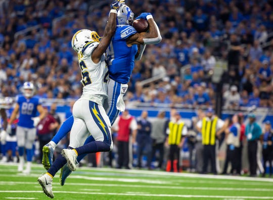 Detroit Lions receiver Kenny Golladay catches the go-ahead touchdown against Los Angeles Chargers cornerback Casey Hayward Jr. in the fourth quarter at Ford Field, Sunday, Sept. 15, 2019. The Lions beat the Chargers, 13-10.