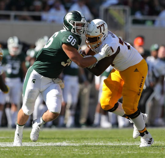 Michigan State Spartans defensive end Jacub Panasiuk rushes against Arizona State offensive lineman LaDarius Henderson during the first half Sept. 14, 2019 at Spartan Stadium.