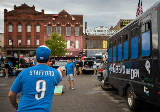 Many tailgaters took to playing the classic corn hole game at tailgating at the Eastern Market for the Detroit Lions' home opener, Sunday, Sept. 15, 2019.
