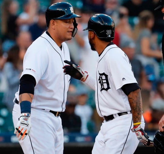 Tigers second baseman Harold Castro receives congratulations from designated hitter Miguel Cabrera after he hits a home run in the third inning on Saturday, Sept. 14, 2019, at Comerica Park.
