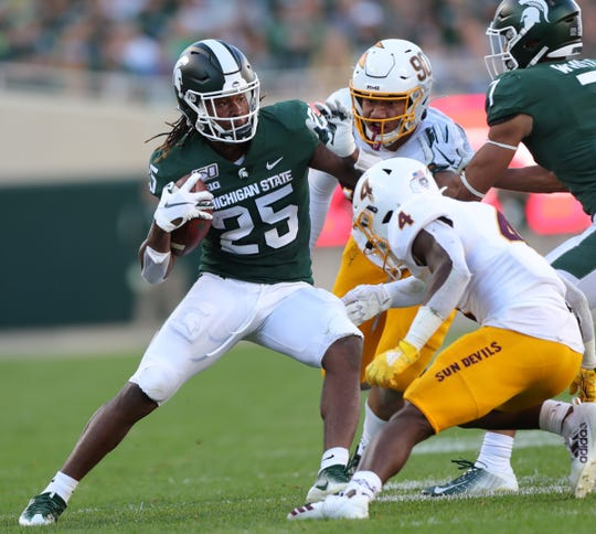 Michigan State Spartans receiver Darrell Stewart Jr. is tackled by Arizona State's Evan Fields (4) and Jermayne Lole (90) during the second half Saturday, Sept. 14, 2019 at Spartan Stadium.