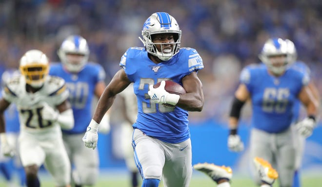 Lions running back Kerryon Johnson runs for a touchdown against the Los Angeles Chargers during the first half on Sunday, Sept. 15, 2019, at Ford Field.