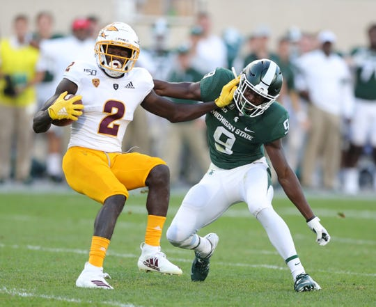 Spartans safety Dominique Long tackles Arizona State receiver Brandon Aiyuk during the second half.