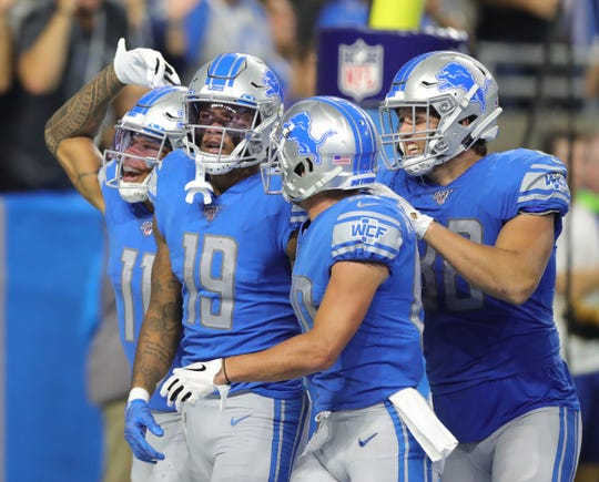 Kenny Golladay (19) celebrates his go-ahead touchdown catch during the fourth quarter.