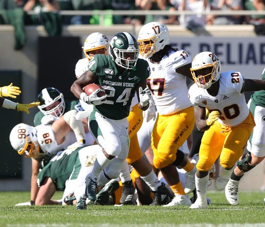 Michigan State running back Elijah Collins runs the ball against Arizona State during the first half Saturday, Sept. 14, 2019, in East Lansing.