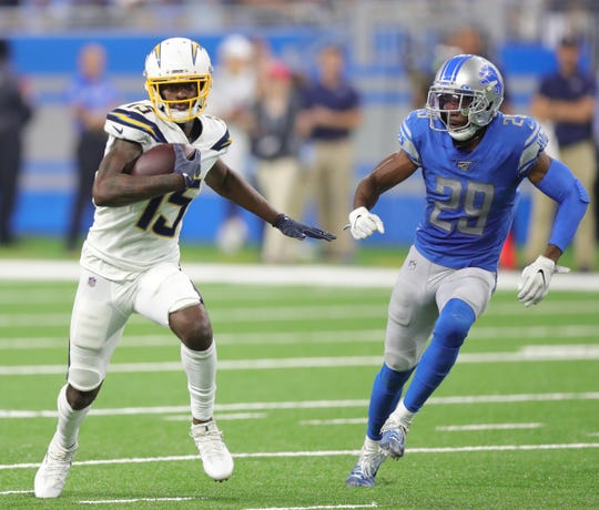 Rashaan Melvin pursues Chargers' Dontrelle Inman during a game last season.