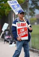 Eddie Mendoza, an employee at the GM-Detroit-Hamtramck assembly plant and UAW Local 22 member, walks the picket line in front of the plant Sunday afternoon in advance of the strike at midnight Sunday.