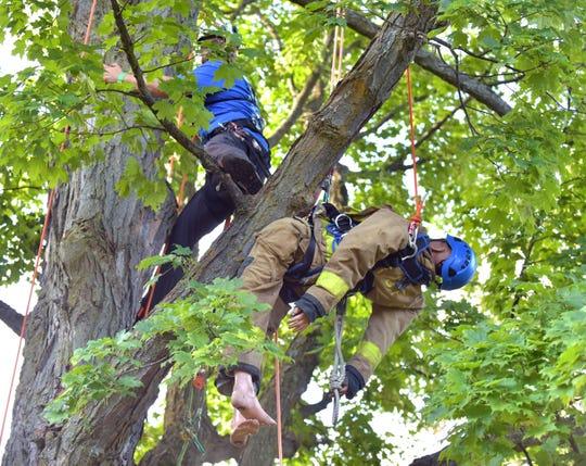 Jordan Lynch, 31, of Mattawan prepares to secure a dummy at the 25th Michigan Tree Climbing Championship on Saturday.