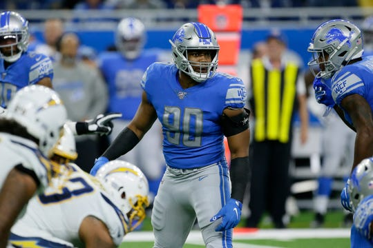 Lions defensive end Trey Flowers communicates with teammates during the game against the Chargers.