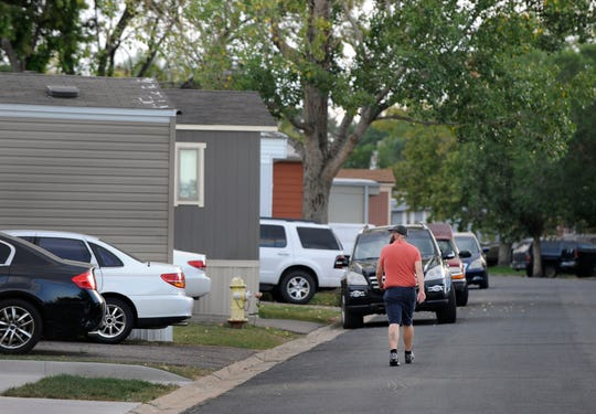 Residents of Lamplighter Village, a manufactured and mobile home park, spending time outdoors in their community in Federal Heights, Colo.