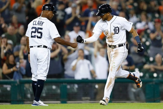 The Detroit Tigers' Victor Reyes celebrates with Dave Clark after hitting a tying solo home run on Saturday night.
