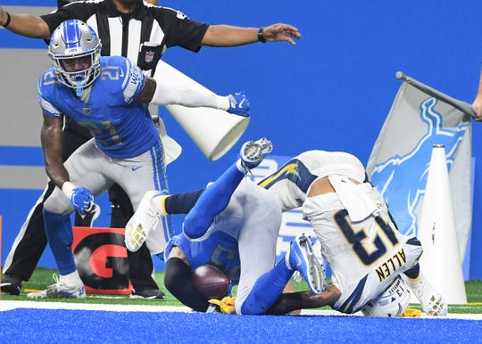 Lions' Darius Slay hangs onto an interception intended for Chargers' Keenan Allen in the end zone late in the fourth quarter.