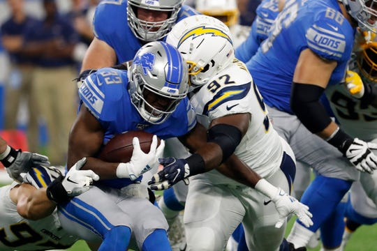 Detroit Lions running back Kerryon Johnson is stopped by Los Angeles Chargers defensive tackle Brandon Mebane.