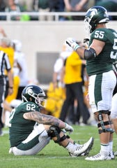 Luke Campbell (62) and Jordan Reid (55) are dejected after MSU's loss to Arizona State.