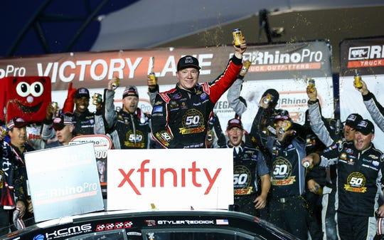 Tyler Reddick, center, celebrates after winning the NASCAR Xfinity Series auto race at Las Vegas Motor Speedway.