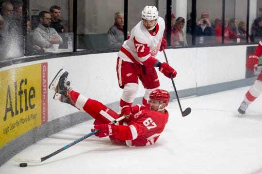 Detroit left wing Taro Hirose hits the ice while trying to keep the puck away from defenseman Oliwer Kaski during the first period during the annual Red-White intrasquad game in Traverse City.