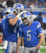 After a missed field goal and extra point, Lions kicker Matt Prater puts away a crucial extra point late in the fourth quarter.