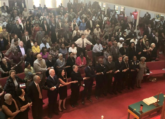 "Presidential candidate and former Vice President Joe Biden, left front, joins the congregation of 16th Street Baptist Church in Birmingham, Alabama, as they sing ""We Shall Overcome"" at Sunday worship on Sept. 15, 2019."
