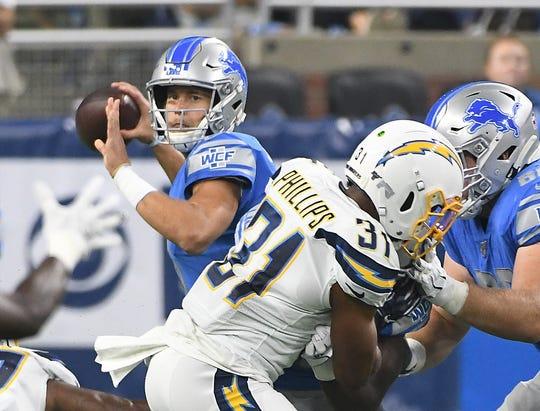 Lions quarterback Matthew Stafford looks for an open receiver.