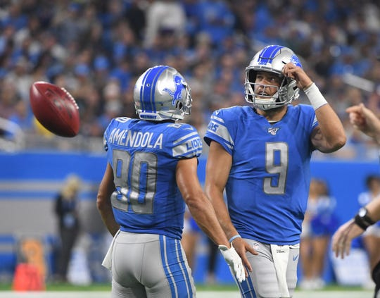 Lions quarterback Matthew Stafford walks off the field after failing to connect with receiver Danny Amendola on a third-down pass in the second quarter.