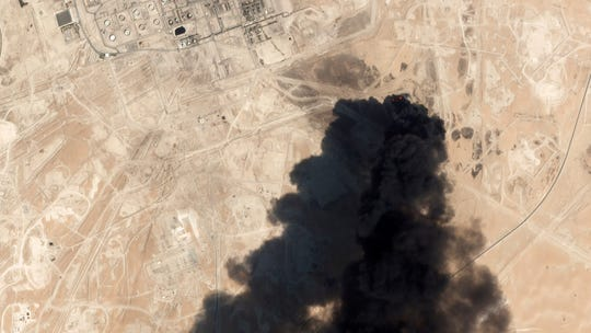 This satellite image from Planet Labs Inc. shows thick black smoke rising from Saudi Aramco's Abqaiq oil processing facility in Buqyaq, Saudi Arabia on Saturday.