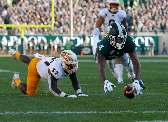 Michigan State's C.J. Hayes can't hang on to a pass against Arizona State's Darien Butler during the second quarter.