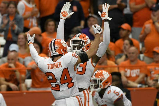 Clemson players Nolan Turner and Lyn-J Dixon celebrate a touchdown against Syracuse.