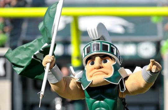 Sparty runs out onto the field before the team.