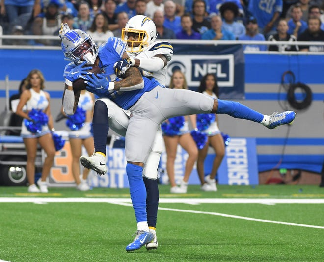 Lions wide receiver Kenny Golladay pulls in the go-ahead touchdown over Chargers' Casey Hayward Jr. in the fourth quarter.