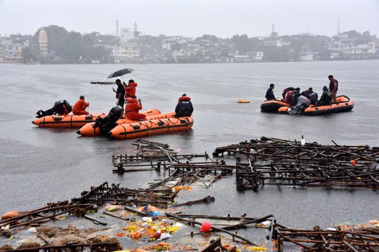 Rescuers conduct search operation on a lake in Bhopal, in the central Indian state for Madhya Pradesh, Friday, Sept. 13, 2019. Police say Hindu worshippers drowned when their boat capsized during a religious celebration on the lake.