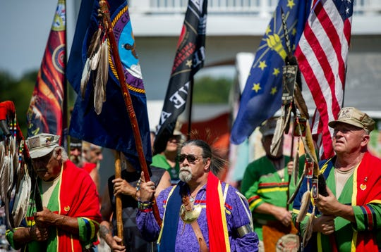 Head Veteran Barry Redbird Brown, center,  a retired Military Veteran of the 101st division of the US Army, along with members of the Ohio Valley Native American Veteran Warrior Society, leads dancers through the eastern door in the Grand Entry to signal the official opening of the Bluff City Pow Wow at Rockport City Park in Rockport, Ind., Sunday afternoon, Sept. 15, 2019.