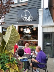 Diners enjoy a table outside White Swan Coffee Lab on Franklin Street on Saturday, Sept. 14, 2019.