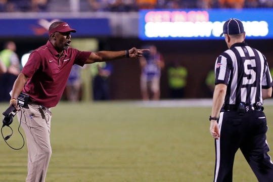 Florida State Seminoles head coach Willie Taggart (L) argues with side judge Michael McCarthy against the Virginia Cavaliers in the fourth quarter at Scott Stadium.