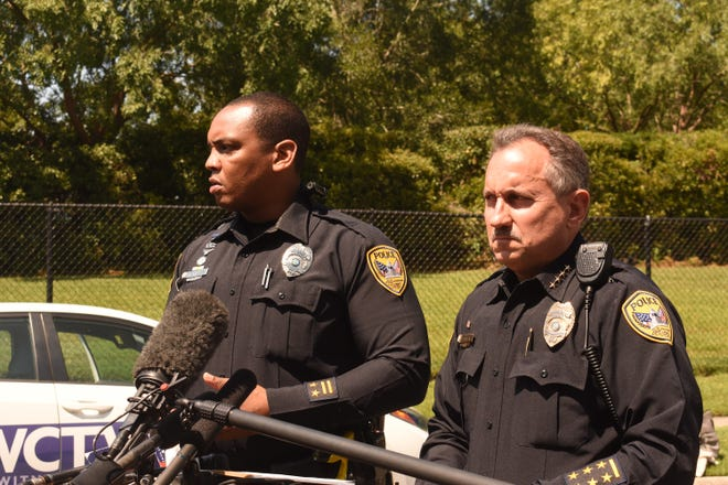 TPD Officer Damon Miller (left) and TPD Chief Steve Outlaw hold a press conference at the scene of the stabbing.