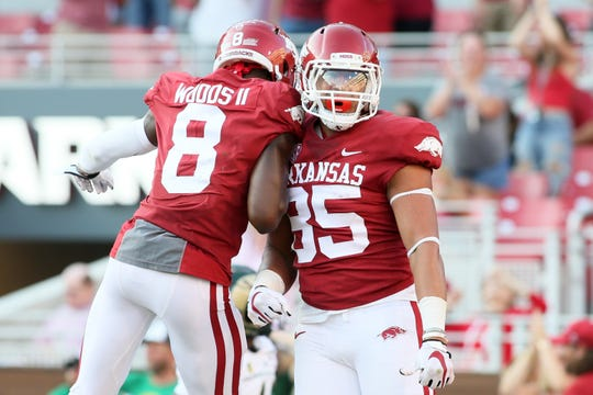 Arkansas Razorbacks tight end Cheyenne O'Grady (85) celebrates with wide receiver Mike Woods II (8) after scoring a touchdown against the Colorado State Rams in the fourth quarter at Donald W. Reynolds Razorback Stadium  Saturday, Sept. 14, 2019.