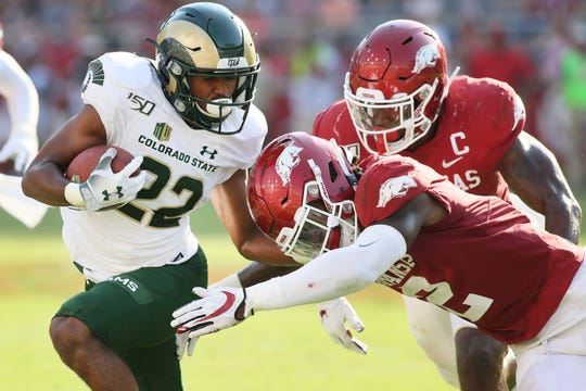 Colorado State Rams wide receiver Dante Wright (22) is tackled by Arkansas Razorbacks safety Kamren Curl (2) in the third quarter at Donald W. Reynolds Razorback Stadium Saturday, Sept. 14, 2019.