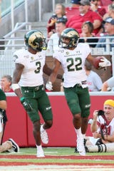 Colorado State Rams wide receivers Dante Wright (22) and E.J. Scott (3) celebrate after a touchdown by Wright against the Arkansas Razorbacks at Donald W. Reynolds Razorback Stadium. Arkansas won 55-34 Saturday, Sept. 14, 2019.