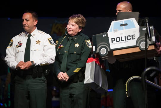 Deputy First Class Donna Aiossa-McNally, of the Lee County Sheriff's Office, center, was named Officer of the Year at the Law and Order Ball on Saturday at Hertz Arena in Estero. Lee County Sheriff Carmine Marceno, left, also attended the annual event that honors members of Lee County law enforcement agencies and was presented by the Rotary Club of Fort Myers South.