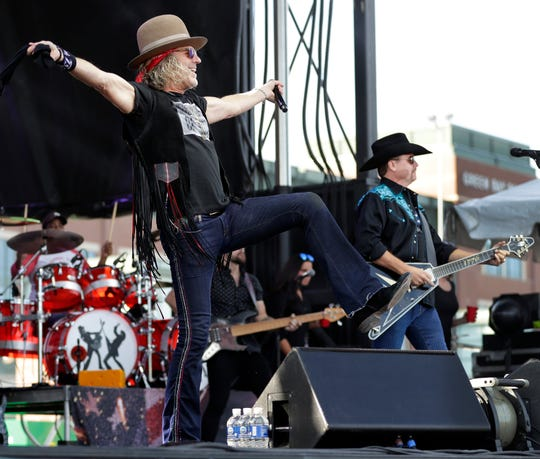 Big & Rich perform a 90-minute free concert outside Lambeau Field on Saturday.