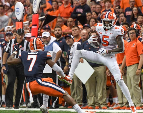 Clemson wide receiver Tee Higgins (5) catches a ball near Syracuse sophomore Andre Cisco(7) during the second quarter at the Carrier Dome in Syracuse, New York, Saturday, September 14, 2019.