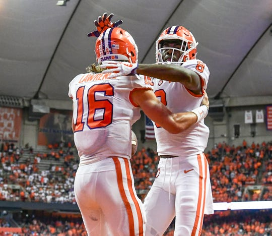 Clemson receiver Justyn Ross congratulates quarterback Trevor Lawrence (16) after scoring a touchdown against Syracuse during the first quarter at the Carrier Dome in Syracuse, New York, Saturday, September 14, 2019.