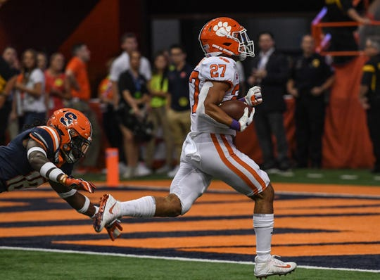 Clemson running back Chez Mellusi(27) runs for a touchdown during the fourth quarter at the Carrier Dome in Syracuse, New York, Saturday, September 14, 2019.