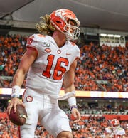 Clemson quarterback Trevor Lawrence (16) scores a touchdown against Syracuse during the first quarter at the Carrier Dome in Syracuse, New York, Saturday, September 14, 2019.
