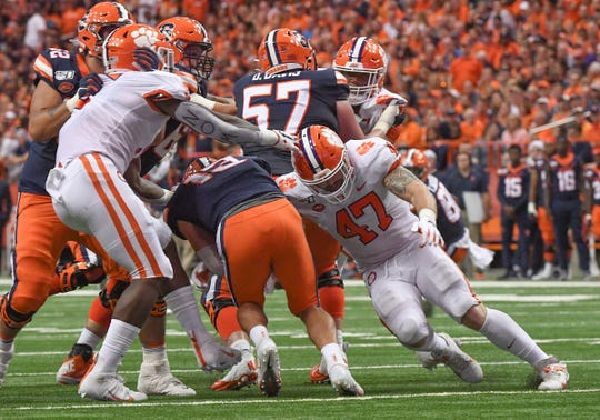 Clemson linebacker James Skalski (47) sacks Syracuse sophomore Tommy DeVito(13) during the second quarter at the Carrier Dome in Syracuse, New York, Saturday, September 14, 2019.