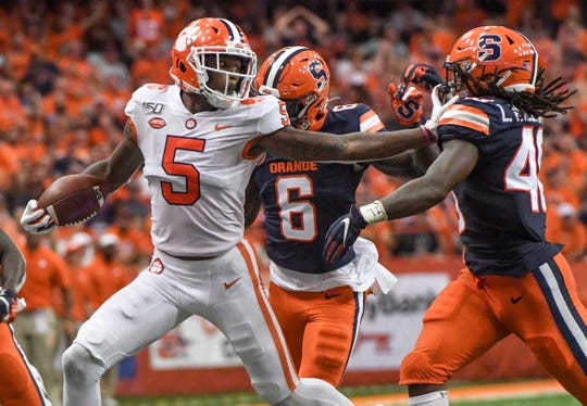 Clemson wide receiver Tee Higgins (5) pushes off Syracuse senior Lakiem Williams(46) during the second quarter at the Carrier Dome in Syracuse, New York, Saturday, September 14, 2019.