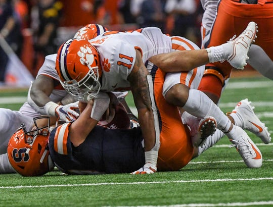 Clemson safety Isaiah Simmons (11) sacks Syracuse sophomore Tommy DeVito(13) on a fourth-and-two play during the third quarter at the Carrier Dome in Syracuse, New York, Saturday, September 14, 2019.