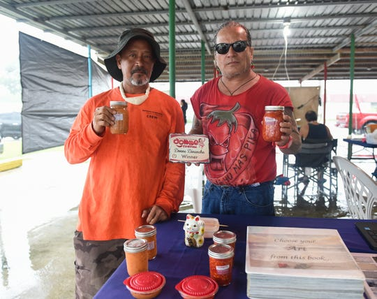 Joseph Aguon, 2015 Mangilao Donne' Festival Donne' Dinanche winner, right, and Mike Hargis, show off Aguon's Pikalicious donne' dinanche brand during the 2019 Mangilao Donne' Festival in Mangilao, Sept. 15, 2019.