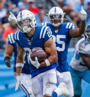 Indianapolis Colts running back Jordan Wilkins (20) breaks away for a 55-yard run in the fourth quarter of their game at Nissan Stadium in Nashville, Tenn., on Sunday, Sept. 15, 2019. The Colts won, 19-17.