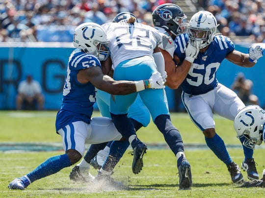 Indianapolis Colts outside linebacker Darius Leonard (53) and middle linebacker Anthony Walker (50) defend against Tennessee Titans running back Derrick Henry (22) in the first quarter of their game at Nissan Stadium in Nashville, Tenn., on Sunday, Sept. 15, 2019.